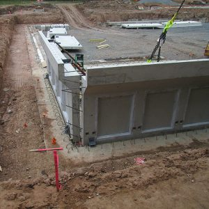 The concrete pool wall sections are set in place.