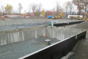 Precast concrete pool walls.