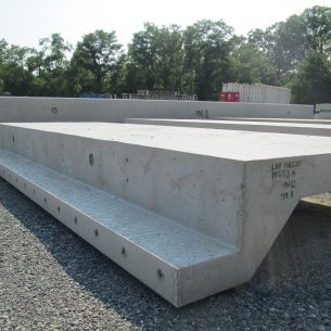 Precast pool wall sections lie to cure in the sun.
