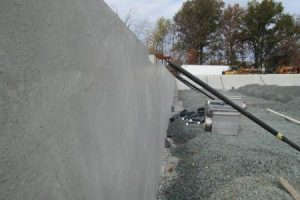 A concrete pool wall section leveled and set.